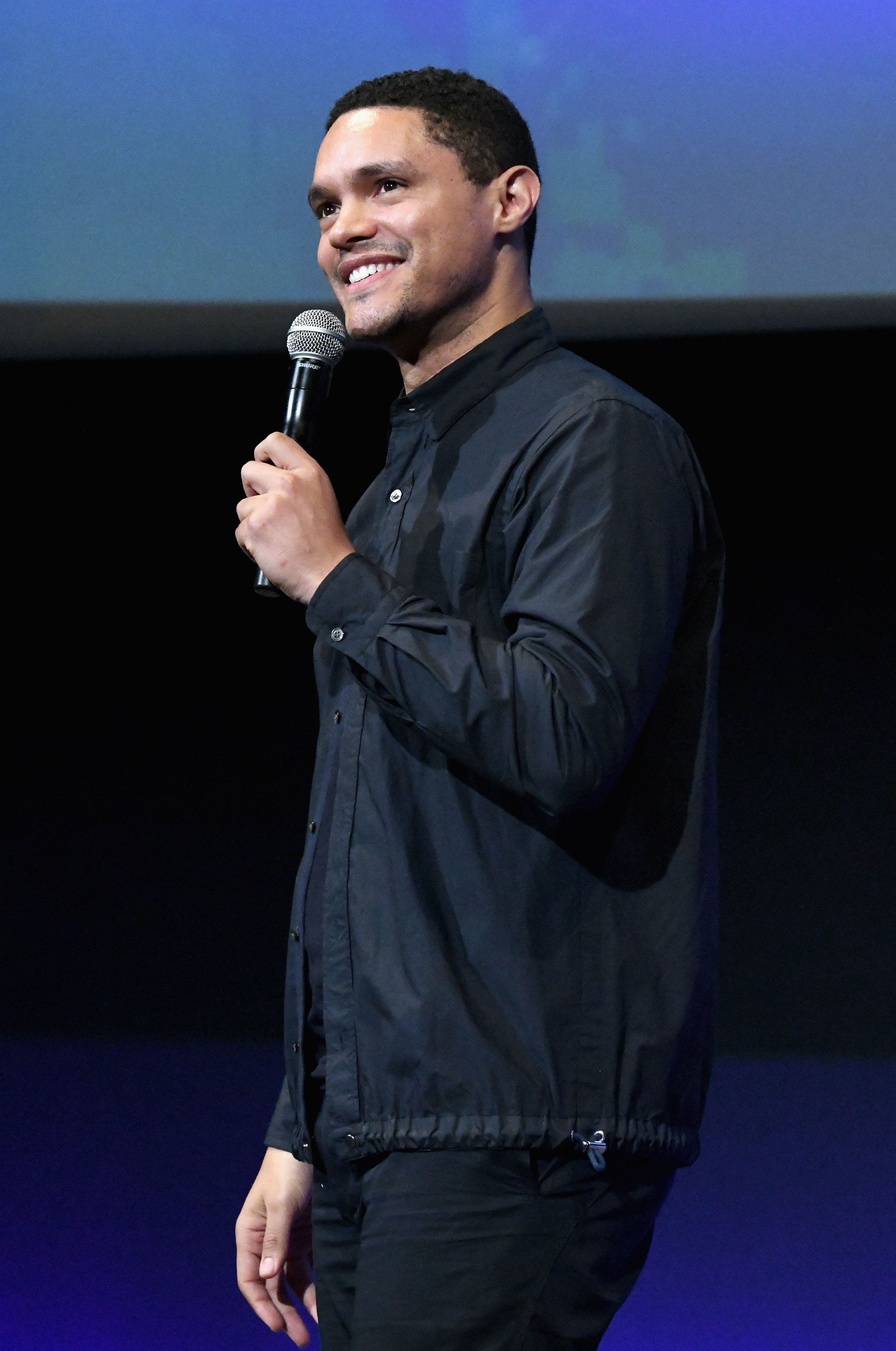 BURBANK, CA - OCTOBER 13:  Trevor Noah performs onstage at the Barbara Berlanti Heroes Gala Benefitting FCancer at Warner Bros. Studios on October 13, 2018 in Burbank, California.  (Photo by Michael Kovac/Getty Images for FCancer)