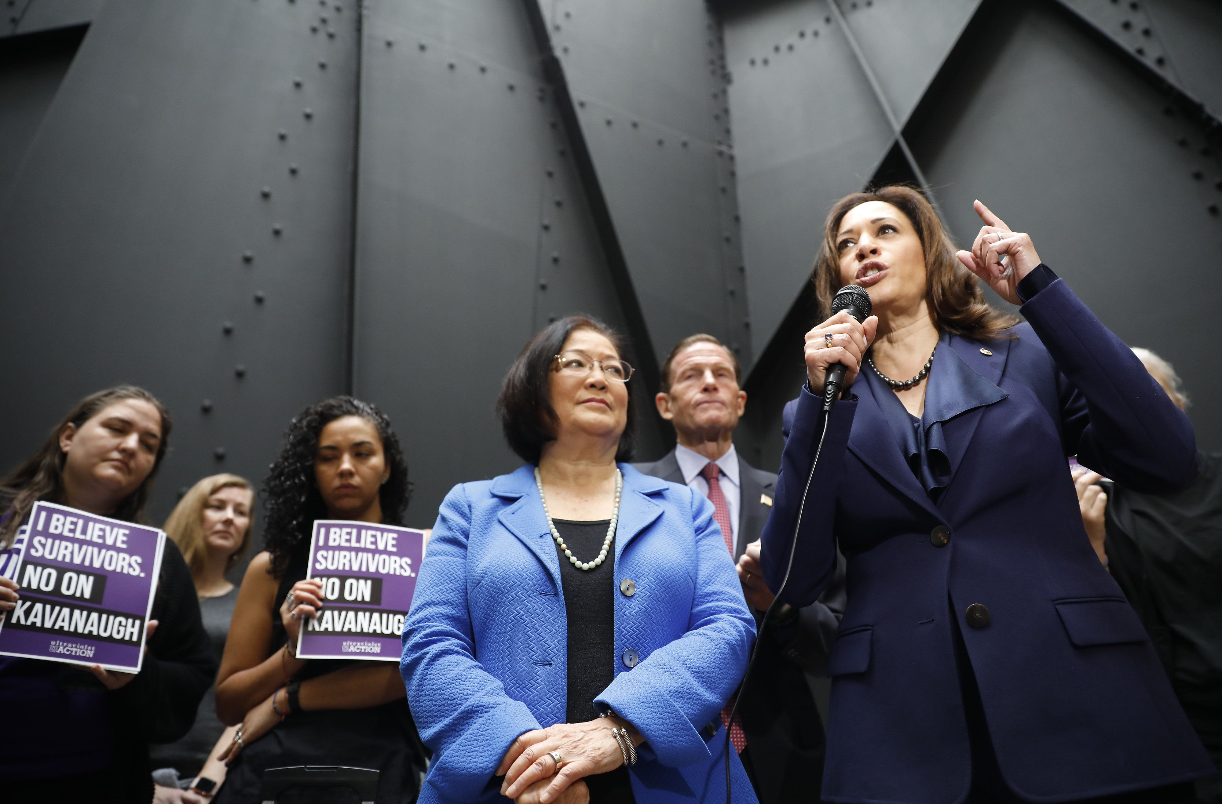 Senator Kamala Harris, a Democrat from California, right, speaks to members of the media after walking out of a markup hearing as Senator Mazie Hirono, a Democrat from Hawaii, listens in Washington, D.C., U.S., on Friday, Sept. 28, 2018. Supreme Court nominee Brett Kavanaugh appears headed toward approval by the Senate Judiciary Committee after pivotal GOP Senator Jeff Flake said he'll vote to confirm the nominee. Photographer: Aaron P. Bernstein/Bloomberg via Getty Images