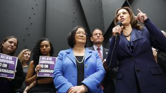 Senator Kamala Harris, a Democrat from California, right, speaks to members of the media after walking out of a markup hearing as Senator Mazie Hirono, a Democrat from Hawaii, listens in Washington, D.C., U.S., on Friday, Sept. 28, 2018. Supreme Court nomineeBrettKavanaughappears headed toward approval by the Senate Judiciary Committee after pivotal GOP SenatorJeff Flakesaid he'll vote to confirm the nominee. Photographer: Aaron P. Bernstein/Bloomberg via Getty Images