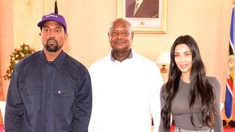Rapper Kanye West (L) and Kim Kardashian (R) pose for a photograph with Uganda's President Yoweri Museveni when they paid a courtesy call at State House, Entebbe, Uganda October 15, 2018. Presidential Press Unit/Handout via REUTERS ATTENTION EDITORS - THIS IMAGE WAS PROVIDED BY A THIRD PARTY.