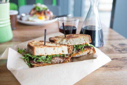 Brider'slamb and harissa sandwich: tender lamb, creamy tzatziki, fresh cucumbers, pepper relish and arugula on ciabatta bread.