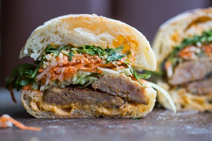 This banh mi is served on ciabatta with enormous pork meatballs, Sriracha mayo and the usual assortment of pickled veggies, cilantro and cucumber.