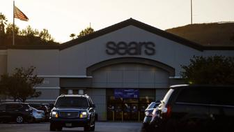 A car drives through the parking lot of a Sears Holdings Corp. store in Montebello, California, U.S., on Wednesday, Oct. 10, 2018. Sears Holdings Corp., the struggling U.S. chain owned by hedge fund manager Eddie Lampert, is preparing for a bankruptcy filing as soon as Sunday, according to a person familiar with the plan. The company faces a critical debt maturity next week. Photographer: Patrick T. Fallon/Bloomberg via Getty Images