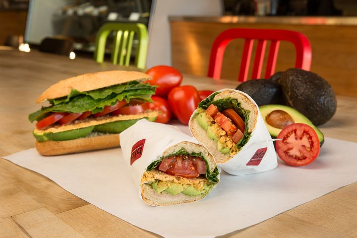A naturally vegetarian (but completely satisfying!) sammie with a stack of avocado, tomatoes, a parmesan crisp, lettuce, and oil and vinegar on a torpedo roll.