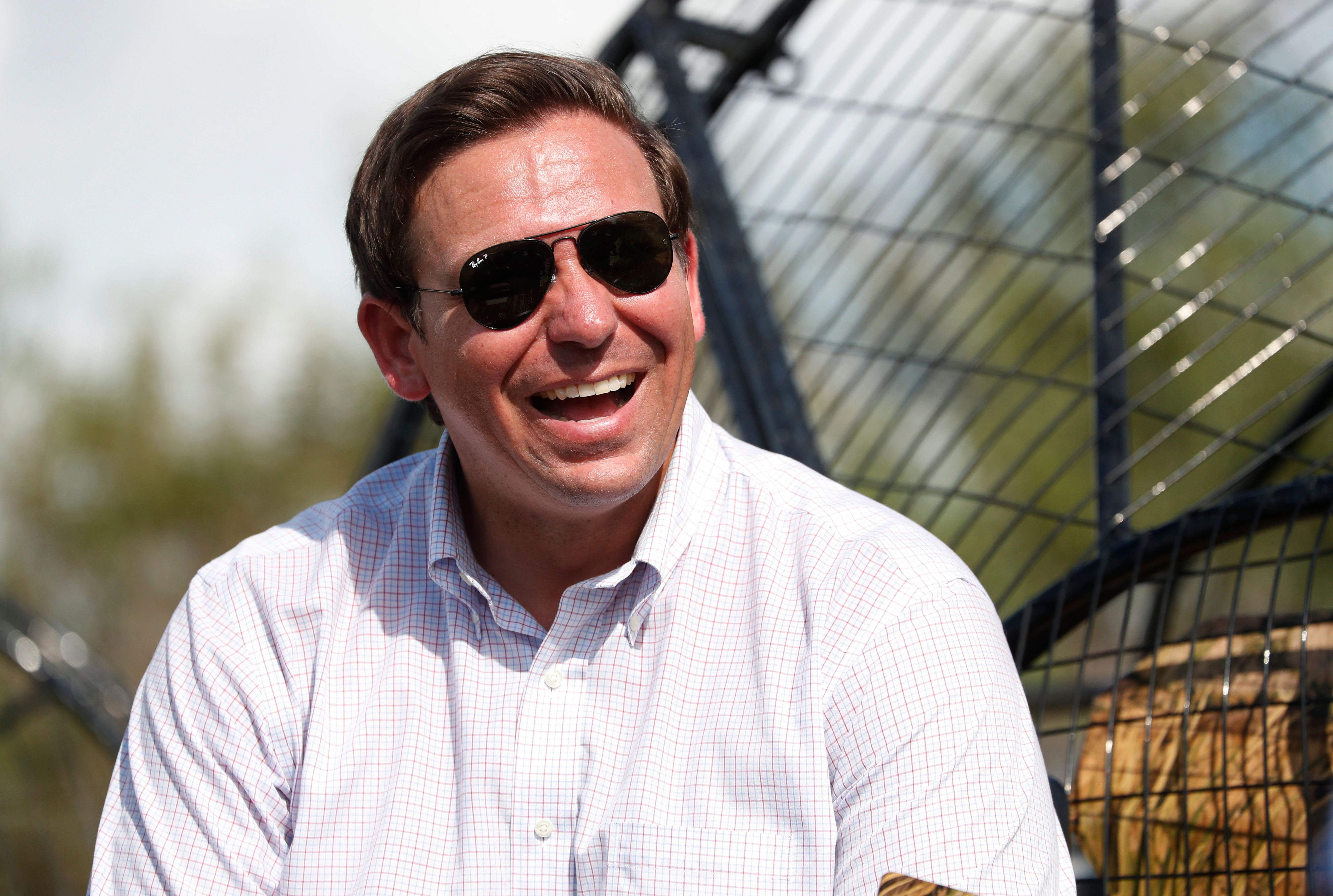 FILE - In this Sept. 12, 2018, file photo, Republican candidate for Florida Governor Ron DeSantis smiles during an airboat tour of the Florida Everglades in Fort Lauderdale, Fla. Top Florida Republicans have been quick to say President Donald Trump is wrong about the death toll in Puerto Rico. DeSantis, who won the GOP primary for governor with Trump's endorsement, also said the president is not correct. (AP Photo/Wilfredo Lee, File)