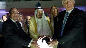 FILE - In this May 21, 2017 file photo, released by the Saudi Press Agency, from left to right, Egyptian President Abdel Fattah al-Sissi, Saudi King Salman, U.S. First Lady Melania Trump and President Donald Trump, visit a new Global Center for Combating Extremist Ideology, in Riyadh, Saudi Arabia. Qatar's answer to a list of demands from four countries lined up against it may be shrouded in secrecy, but the message it delivered this week was clear enough: it is not about to roll over. (Saudi Press Agency via AP, File)