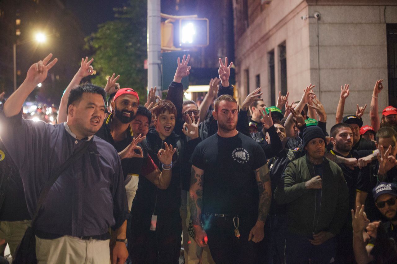 Members of the Proud Boys pose for a group photo on the night of their attack outside the Metropolitan Republican Club in New York City.