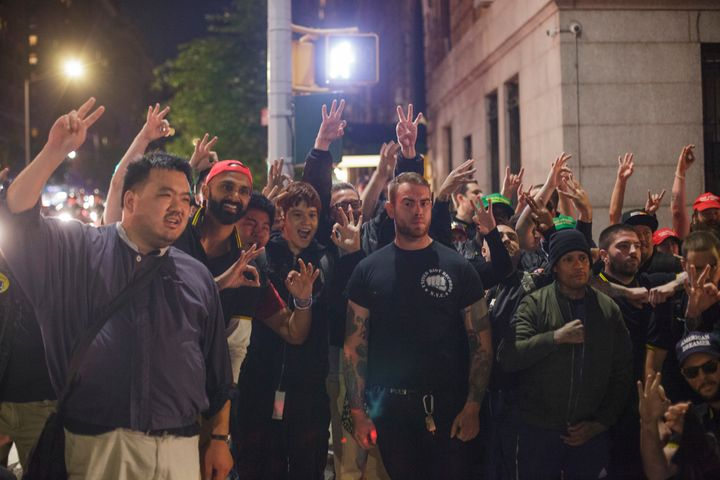 Members of the Proud Boys gather for a photo in New York City the same October night that several of them attacked protesters