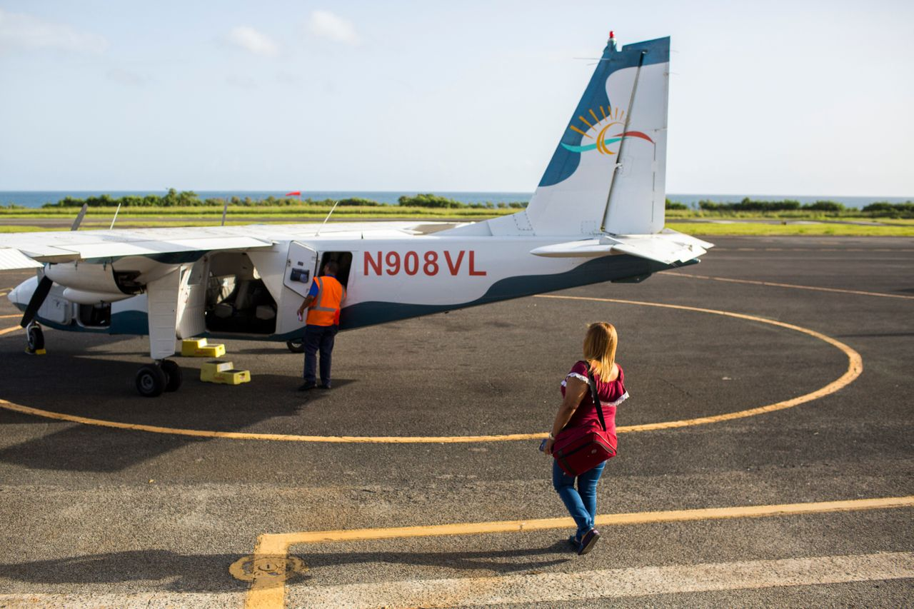 Leyla Rivera Acosta walks toward the small eight-seat aircraft that transports her and other dialysis patients in Vieques three times a week to the main island to receive their life-saving treatment.