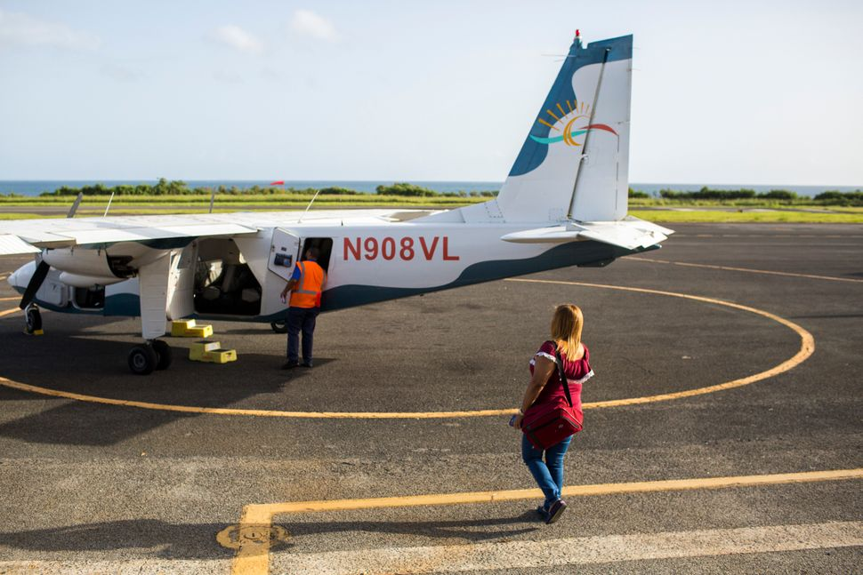 Leyla Rivera Acosta walks toward the small eight-seat aircraft that transports her and other dialysis patients in Vieques thr