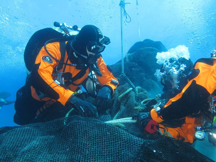 Divers from Ghost Fishing work to recover a massive fishing net abandoned a decade ago off the coast of the Aeolian Isla