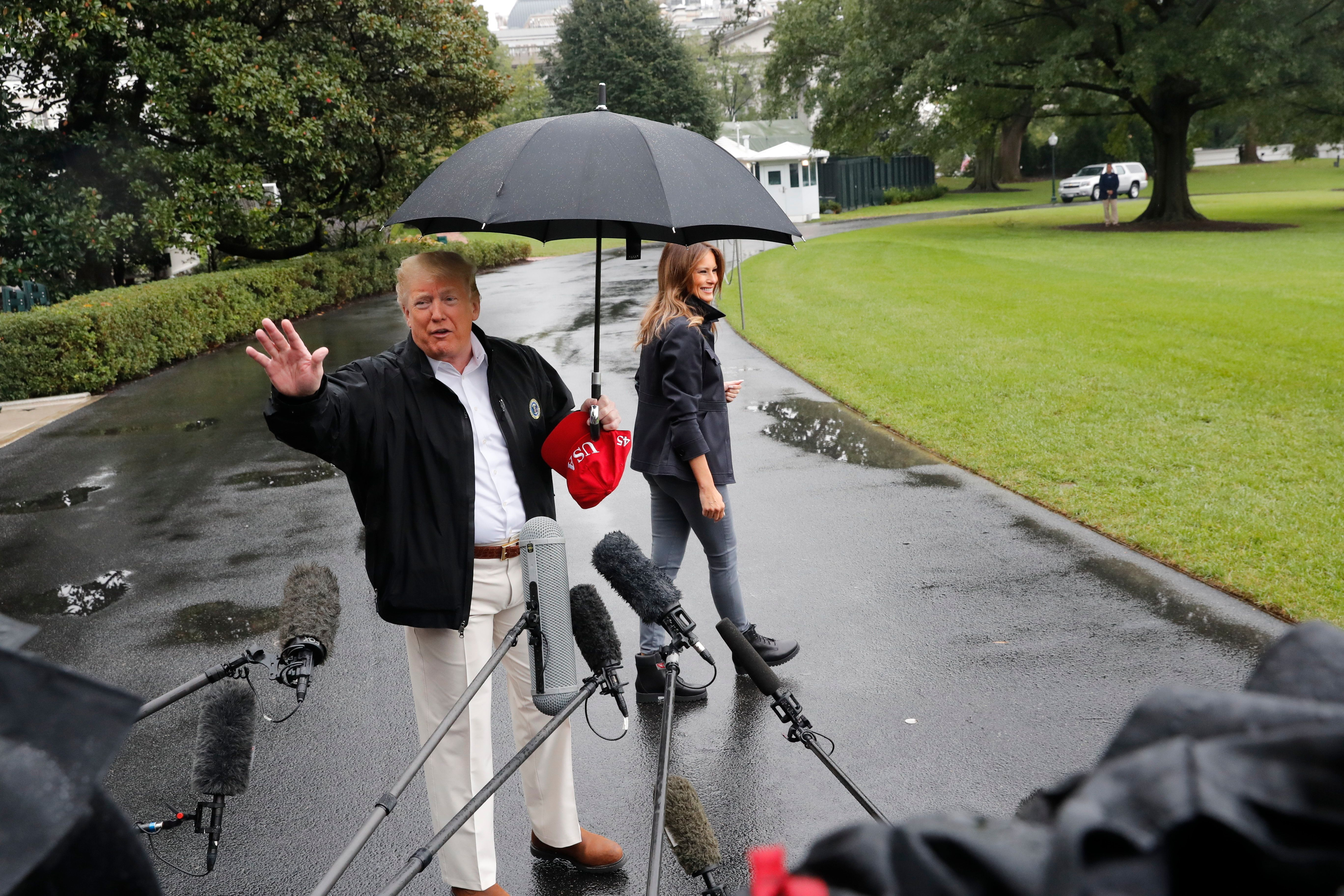President Donald Trump and first lady Melania Trump walk across the South Lawn of the White House in Washington, Monday, Oct. 15, 2018, to board Marine One helicopter for a short trip to Andrews Air Force Base, Md., en route to Florida to tour areas the devastation left behind from Hurricane Michael last week. (AP Photo/Pablo Martinez Monsivais)