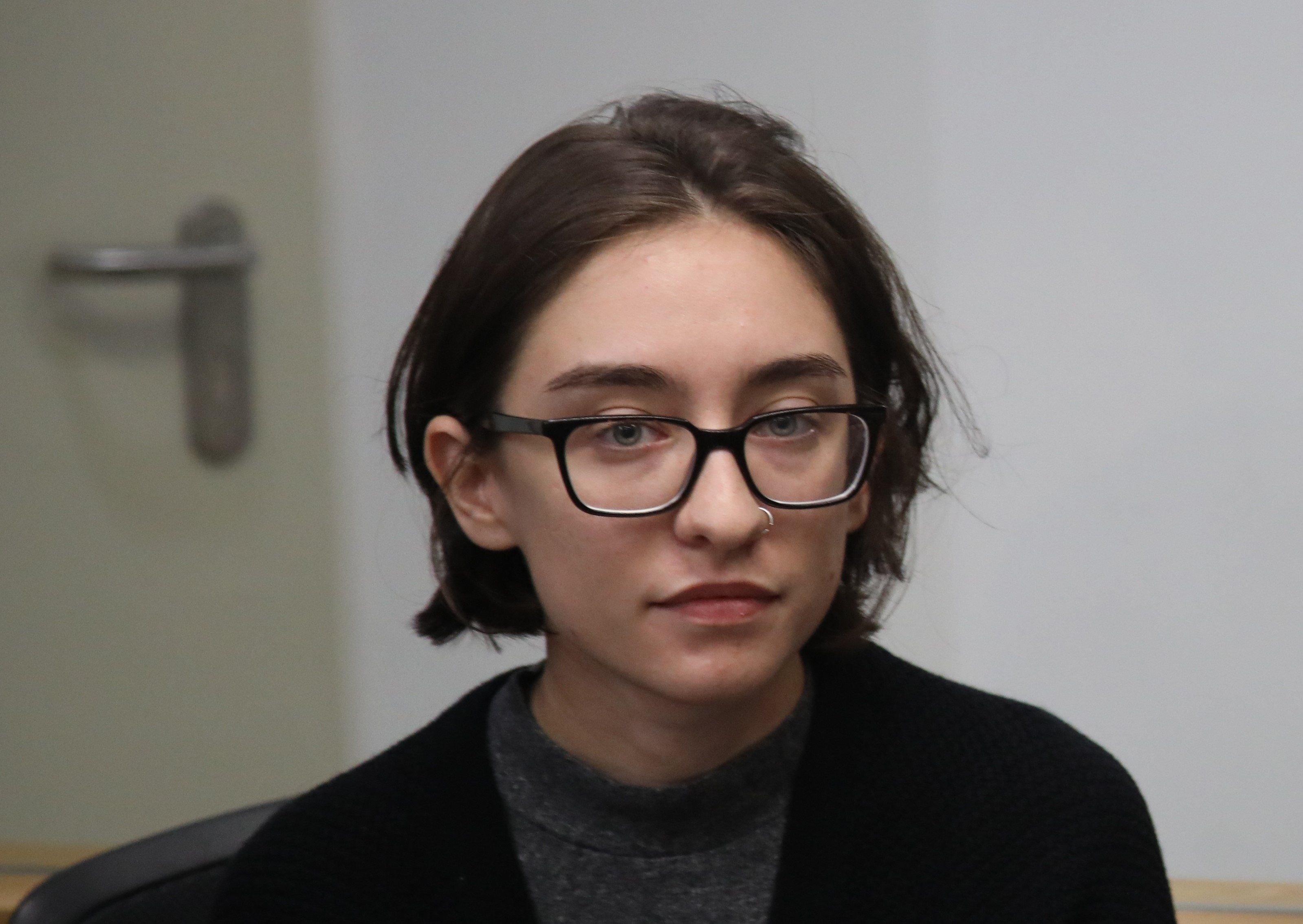 TEL AVIV, ISRAEL - OCTOBER 11: 22-year-old U.S. citizen Lara Alqasem, who has been held by Israeli authorities for a week appears in a court in Tel Aviv, Israel on October 11, 2018. Lara Alqasem has been in Israeli custody since arriving at Ben Gurion International Airport last Tuesday with a valid student visa hoping to study law, human rights and freedom of travel at Hebrew University in Jerusalem. Israeli officials are denying Alqasem entry based on allegations that she supported the Boycott, Divestment and Sanctions (BDS) movement, which urges businesses, educational institutions and celebrities to cut ties with Israel. (Photo by Mostafa Alkharouf /Anadolu Agency/Getty Images)