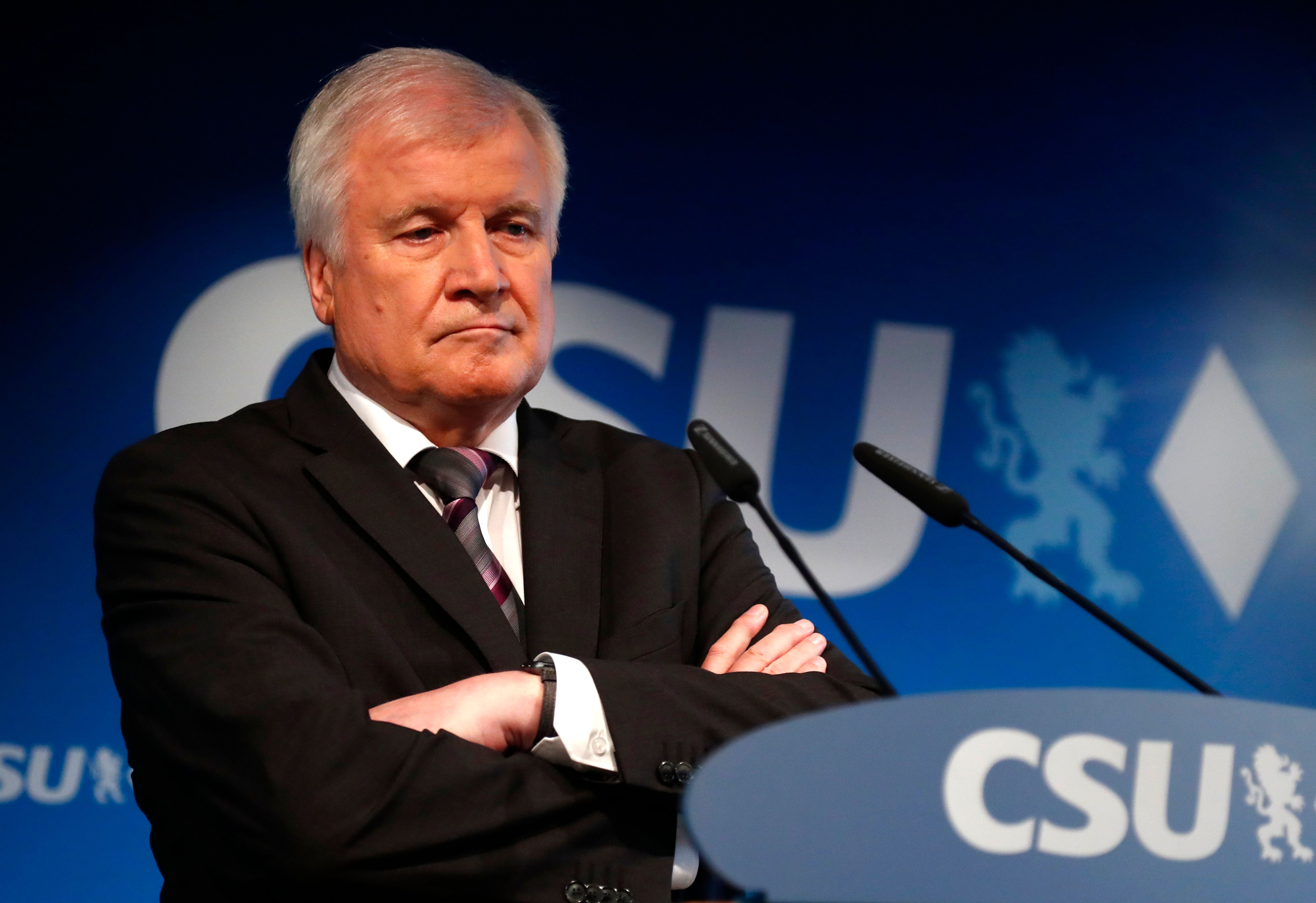 German Interior Minister and CSU chairman Horst Seehofer attends a press conference at the headquarters of the Christian Social Union, CSU, in Munich, Germany, Monday, Oct. 15, 2018, the day after their party lost the absolute majority in Bavaria's state parliament by a wide margin. (AP Photo/Matthias Schrader)