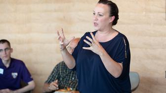 MJ Hegar, Texas Democratic Candidate for US Representative District 31, speaks to voters at an MJ Out and About in Georgetown' event on September 15, 2018 at The Den at Wolf Ranch in Georgetown, Texas. (Photo by SUZANNE CORDEIRO / AFP) / With AFP Story by  Michael MATHES        (Photo credit should read SUZANNE CORDEIRO/AFP/Getty Images)