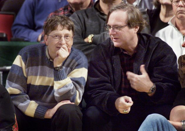 Microsoft co-founders Bill Gates (l) andPaulAllen chat at courtside during the NBA game between the Seattle SuperSonics and the Portland Trailblazers at Key Arena in Seattle in 2003