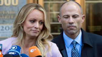 "FILE - In this April 16, 2018 file photo, adult film actress Stormy Daniels, left, stands with her lawyer Michael Avenatti as she speaks outside federal court, in New York. The Justice Department says Avenatti, made ""misrepresentations"" in a bankruptcy case involving his former law firm that owes more than $440,000 in unpaid federal taxes. Avenatti said Wednesday, July 4, 2018, he doesn't owe any money personally and called the court filing ""politically motivated."" (AP Photo/Mary Altaffer, File)"