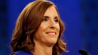 U.S. Rep. Martha McSally, R-Ariz., goes over the rules in a television studio prior to a televised debate with U.S. Rep. Kyrsten Sinema, D-Ariz., Monday, Oct. 15, 2018, in Phoenix. Both ladies are seeking to fill the seat of U.S. Sen. Jake Flake, R-Ariz. who is retiring. The Arizona Senate contest is one of the most closely-watched in the nation. (AP Photo/Matt York)