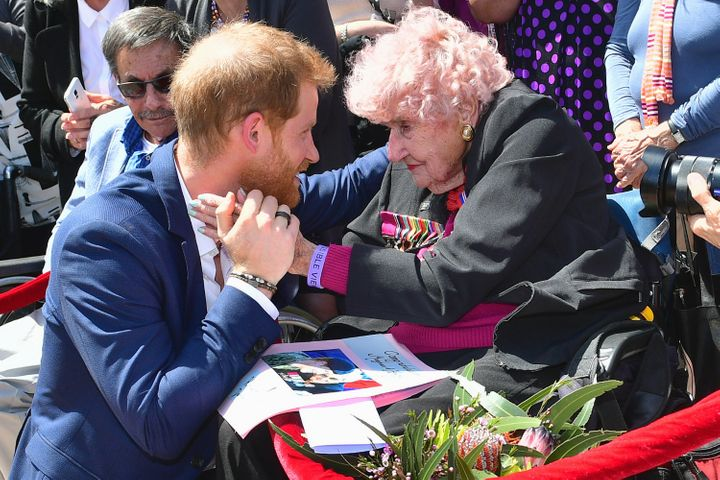 Britain's Prince Harry greets Daphne Dunne again in Sydney.