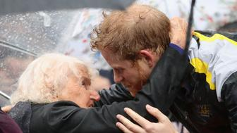 SYDNEY, AUSTRALIA - JUNE 07:  Patron of the Invictus Games Foundation Prince Harry hugs 97 year old Daphne Dunne during a walkabout in the torrential rain ahead of a Sydney 2018 Invictus Games Launch Event at the Overseas Passenger Terminal on June 7, 2017 in Sydney, Australia. Prince Harry is on a two-day visit to Sydney for the launch of the Invictus Games Sydney 2018. The fourth Invictus Games will be held in Sydney from 20th to 27th October, 2018 and will include over 500 competitors from 17 nations competing in 10 adaptive sports events.  (Photo by Chris Jackson/Getty Images)