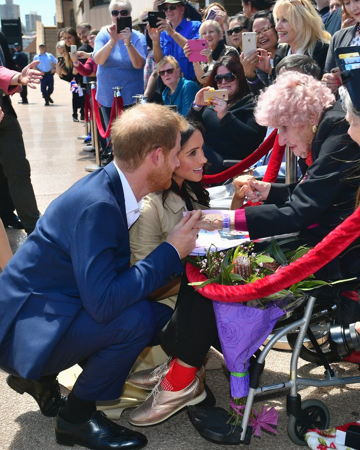 Prince Harry brought his wife over to meet Daphne Dunne.