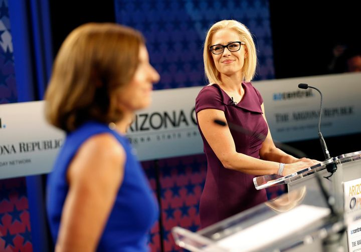 Rep. Kyrsten Sinema (D-Ariz.), right, debated Republican Martha McSally on Monday night. They are competing for the Senate se