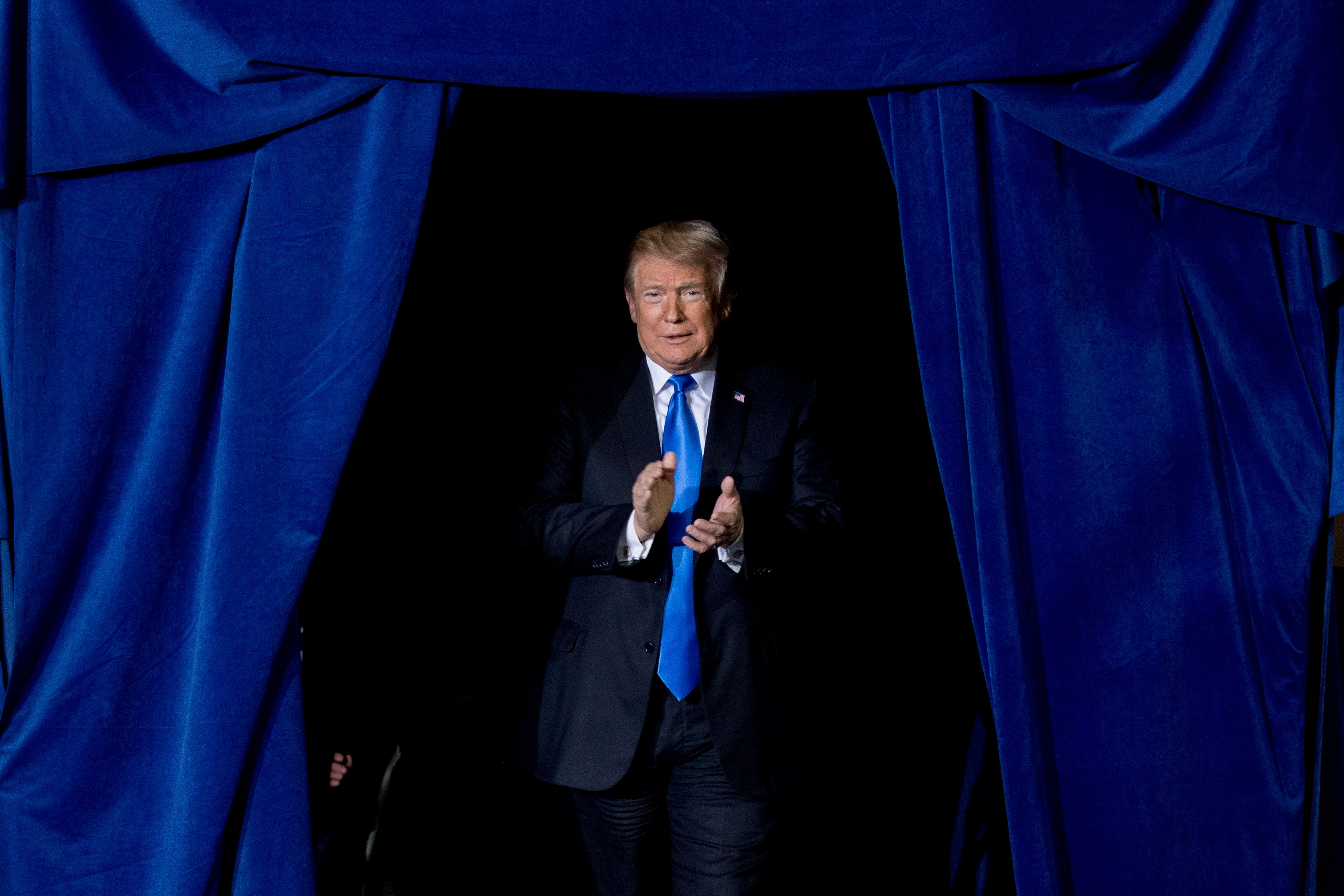 President Donald Trump takes the stage at a rally at Alumni Coliseum in Richmond, Ky., Saturday, Oct. 13, 2018. (AP Photo/Andrew Harnik)