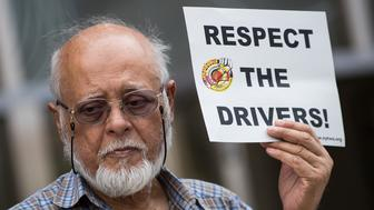NEW YORK, NY - AUGUST 6: For-hire drivers and their supporters rally in favor of proposed New York City legislation that would put a cap on ride-hailing vehicles outside the headquarters of the New York City Taxi and Limousine Commission, which also houses offices of Uber and Lyft, August 6, 2018 in New York City. New York City Council is set to consider legislation this week that would cap ride-hailing vehicles in the city and set a minimum pay rate for drivers. If passed, the legation would make New York City the first major American city to set a limit on ride-hailing vehicles. (Photo by Drew Angerer/Getty Images)