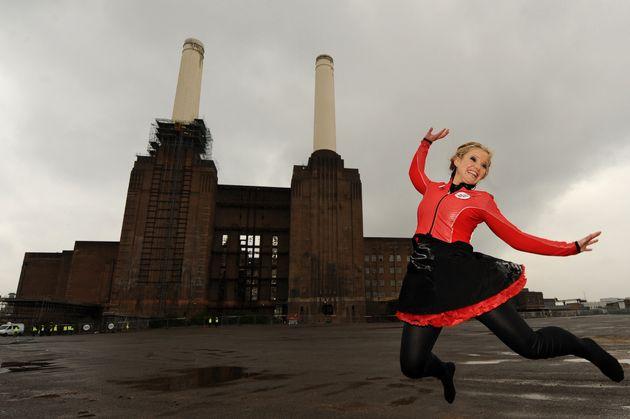 Helen Skelton walked a 150m long, 66m high tightrole between the chimneys of Battersea Power
