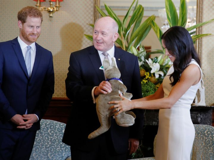 Meghan admiring the stuffed animal.