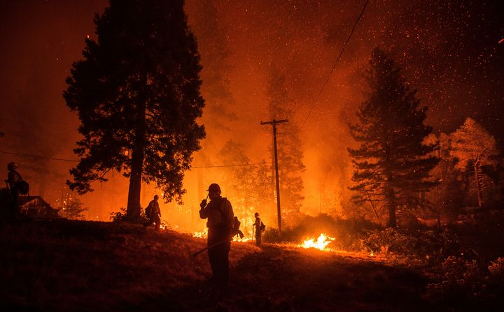 Firefighters monitor a backfire while battling the Delta fire in the Shasta-Trinity National Forest in California in Septembe