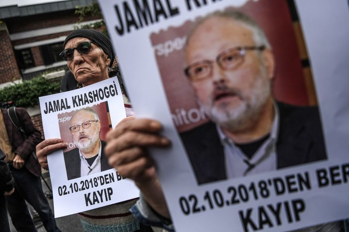 "Protesters hold a portrait of missing journalist and Riyadh critic Jamal Khashoggi reading ""Jamal Khashoggi is missing since"
