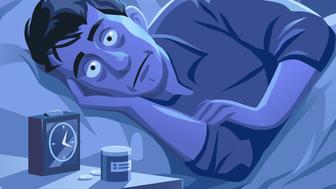 Vector illustration of a young man lying in his bed, trying to sleep. His eyes are open and he is looking desperate and exhausted. In front of him is an alarm clock and sleeping pills. The bedroom is brightly lit from the moonlight and the city lights outside the window.