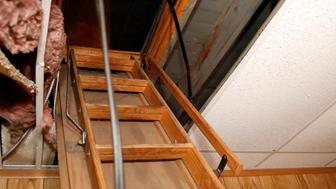 A small crawlspace near the top of the pull down ladder at the former Cantrell Funeral Home, seen Monday, Oct. 15, 2018, was the area where Michigan inspectors found badly decomposed remains of 11 infants hidden in a ceiling compartment of the shuttered Detroit funeral home. (AP Photo/Carlos Osorio)