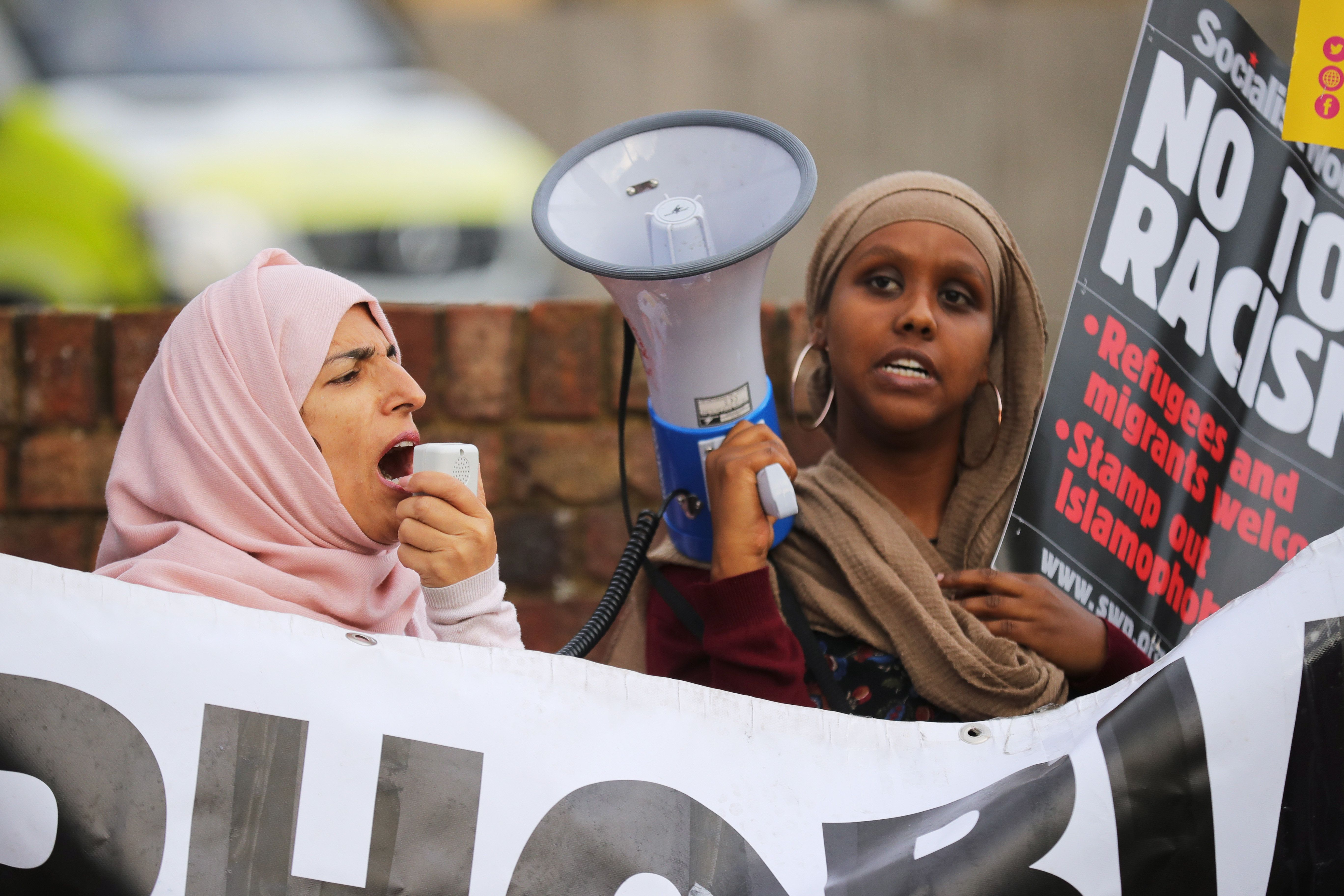 UXBRIDGE, ENGLAND - AUGUST 09:  Local people protest outside the Hillingdon Conservative Association office on August 9, 2018 in Uxbridge, England. Today's protest is being held following comments made by former Foreign Secretary, Boris Johnson, against the wearing of Burkas by Muslim women in the United Kingdom. An independent panel will investigate complaints made regarding Mr Johnson's comments and possible breaches of the Conservative Party code of conduct.  (Photo by Christopher Furlong/Getty Images)