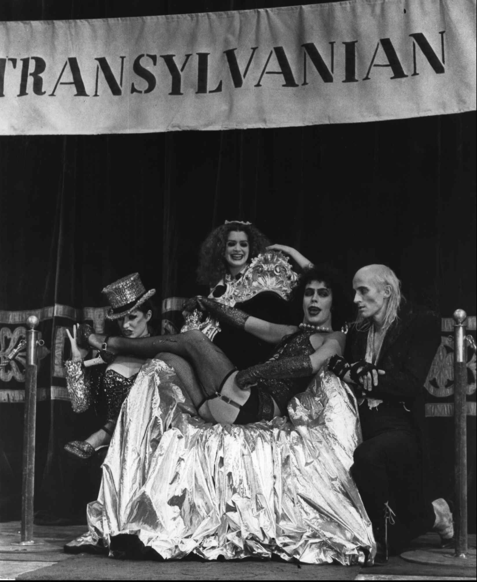 "FILE--This a 1975 file photo of Tim Curry, center, who plays Frank N. Furter dressed a transvestite, singing ""Sweet Transvestite"" with Little Nell,left, who plays Columbia, Patricia Quinn, who plays Magenta and Richard O'Brien ,right,in the role of Riff Raff in this scene from the movie, The Rocky Horror Picture Show.(AP Photo)"