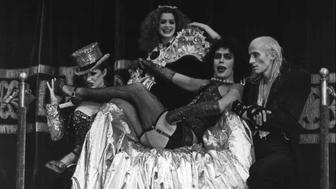 """FILE--This a 1975 file photo of Tim Curry, center, who plays Frank N. Furter dressed a transvestite, singing """"Sweet Transvestite"""" with Little Nell,left, who plays Columbia, Patricia Quinn, who plays Magenta and Richard O'Brien ,right,in the role of Riff Raff in this scene from the movie, The Rocky Horror Picture Show.(AP Photo)"""