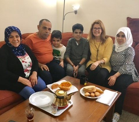 The author (second from right) with one of her current pediatric hospice families. The family is originally from Syria and ha