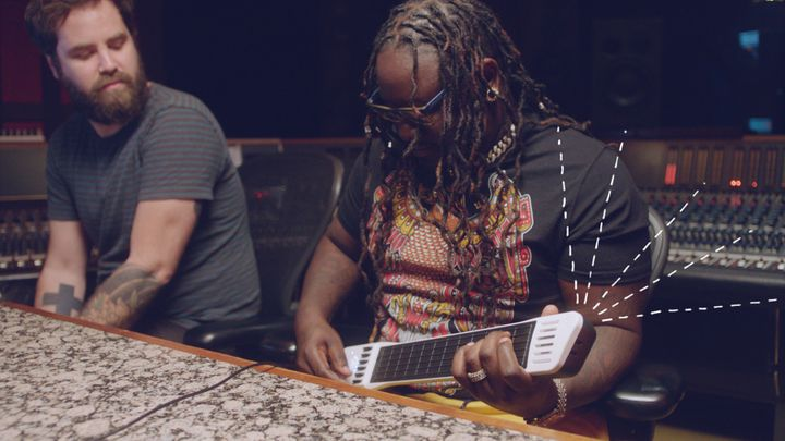 T-Pain toys with a digital guitar on his new show.
