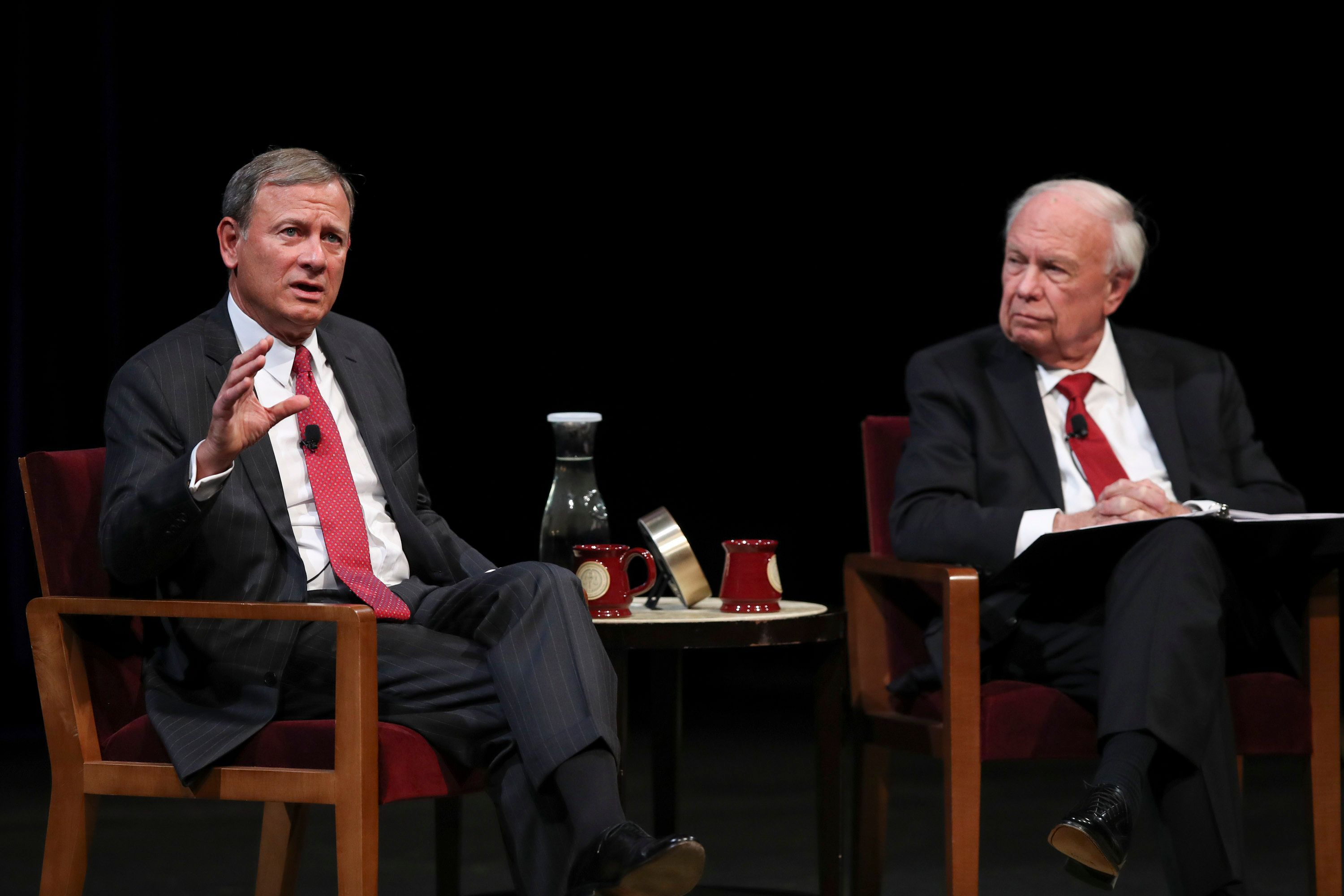 U.S. Supreme Court Chief Justice John Roberts, Jr., left, answers a student's question following his conversation with Professor Robert A. Stein Tuesday, Oct. 16, 2018 at Northrop Auditorium in Minneapolis. (Jeff Wheeler/Star Tribune via AP)