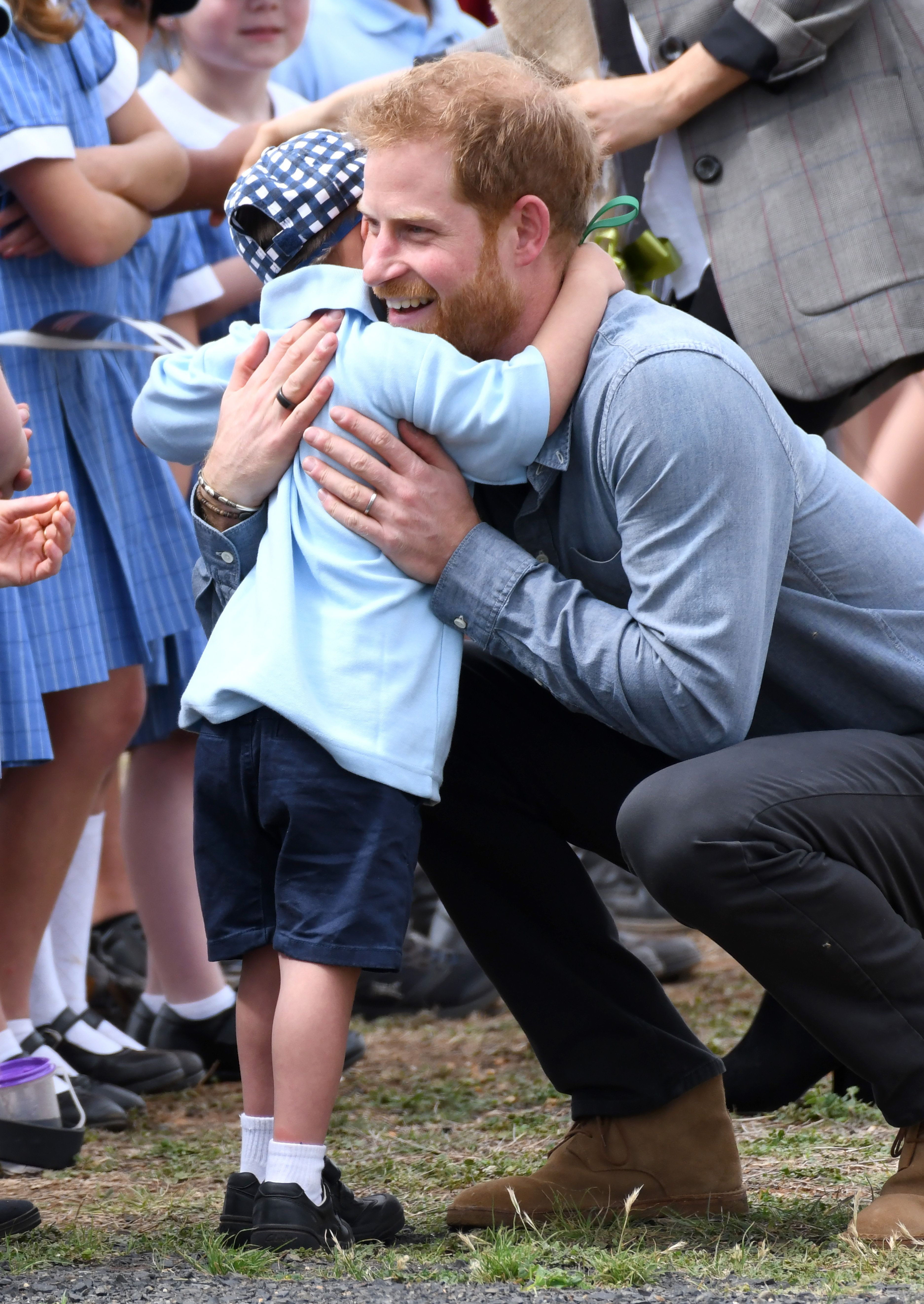 Prince Harry And Meghan Get Enthusiastic Hugs From 5-Year-Old Boy And Our Hearts Are