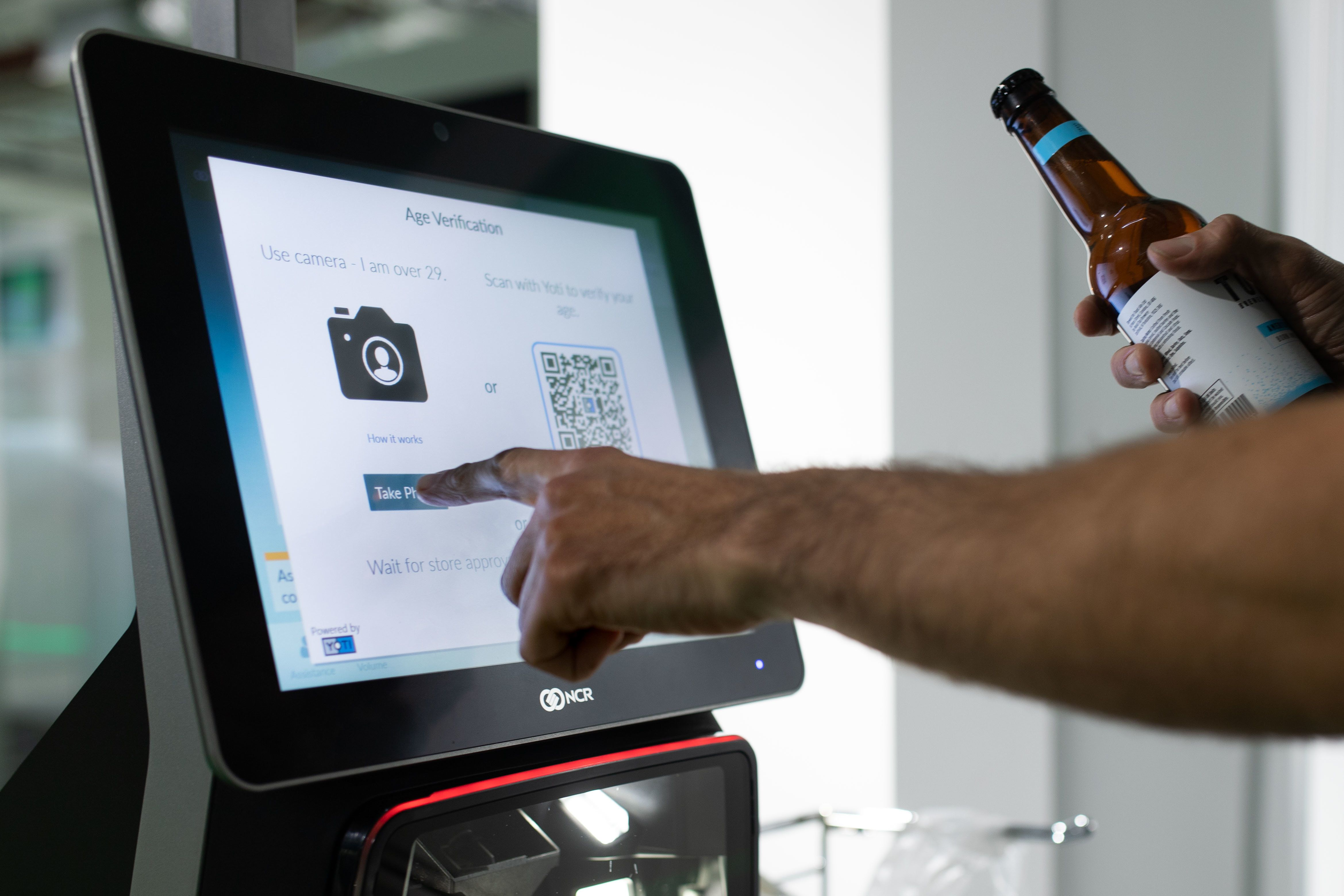 AIRPORT ID: Self-Service Checkouts Will Start Using Facial Recognition To Decide If You're Over