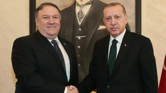 ANKARA, TURKEY - OCTOBER 17: (----EDITORIAL USE ONLY  MANDATORY CREDIT - 'TURKISH PRESIDENCY / MURAT CETINMUHURDAR / HANDOUT' - NO MARKETING NO ADVERTISING CAMPAIGNS - DISTRIBUTED AS A SERVICE TO CLIENTS----) President of Turkey Party Recep Tayyip Erdogan (R) and US Secretary of State Mike Pompeo (L) shake hands during their meeting at Esenboga International Airport in Ankara, Turkey on October 17, 2018. (Photo by Turkish Presidency / Murat Cetinmuhurdar / Handout/Anadolu Agency/Getty Images)