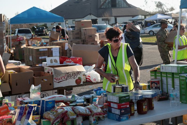 Volunteers help distribute food, water, cleaning supplies and other necessities to victims of Hurricane Michael at an aid dis