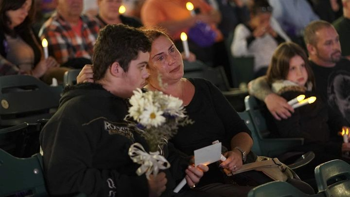 Kimberly Ruediger holds her son Gabriel, as they participate in an October 2017 candlelight vigil in Camden, New Jersey, in r