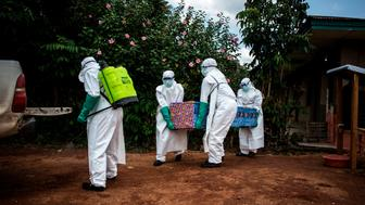 Health workers carry out the body of a patient with unconfirmed Ebola virus on August 22, 2018 in Mangina, near Beni, in the North Kivu province. - Sixty-one people have died in the latest outbreak of Ebola in the Democratic Republic of Congo (DRC), the authorities said, adding that four novel drugs had been added to the roster of treatments. The outbreak began on August 1 in Mangina, the epicentre of the outbreak in the North Kivu province, and cases have been reported in neighbouring Ituri province. It is the 10th outbreak to strike the DRC since 1976, when Ebola was first identified and named after a river in the north of the country. (Photo by John WESSELS / AFP)        (Photo credit should read JOHN WESSELS/AFP/Getty Images)