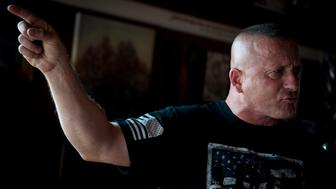 UNITED STATES - July 5: Richard Ojeda speaks with Roll Call inside Hot Cup, a local coffee shop in Logan, West Virginia Thursday July 5, 2018. Ojeda is a first-term lawmaker from southern West Virginia running to represent the states 3rd Congressional District as a Democrat. Ojeda is best known as the Democrat who voted for President Trump and who was brutally beaten in an ambush the day before the primaries. (Photo By Sarah Silbiger/CQ Roll Call)