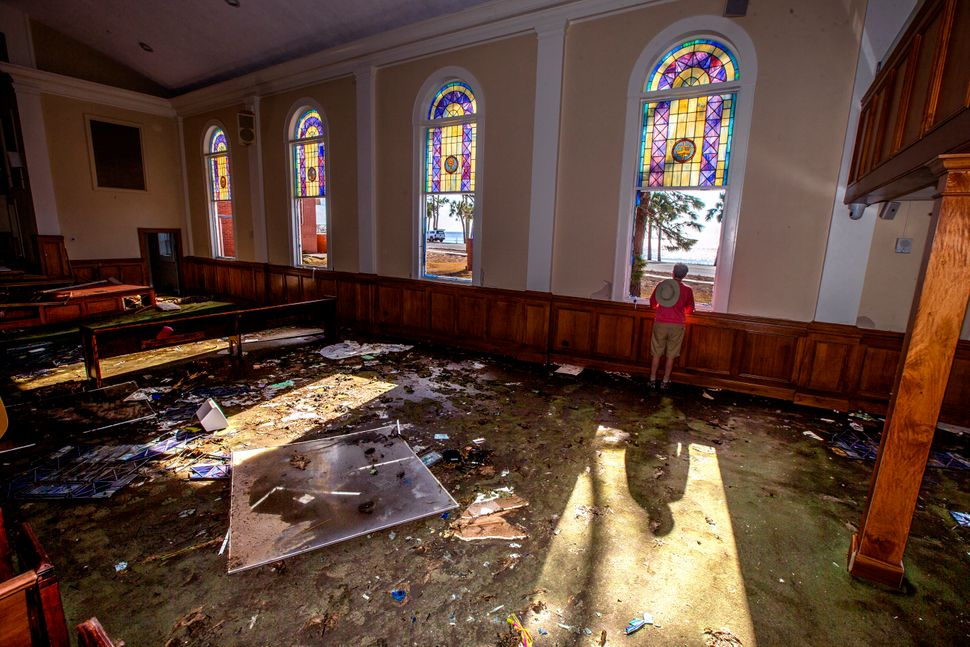 The Rev. Geoffrey Lentz looks out at St. Joe Bay from his sanctuary of the First United Methodist Church after it was gutted