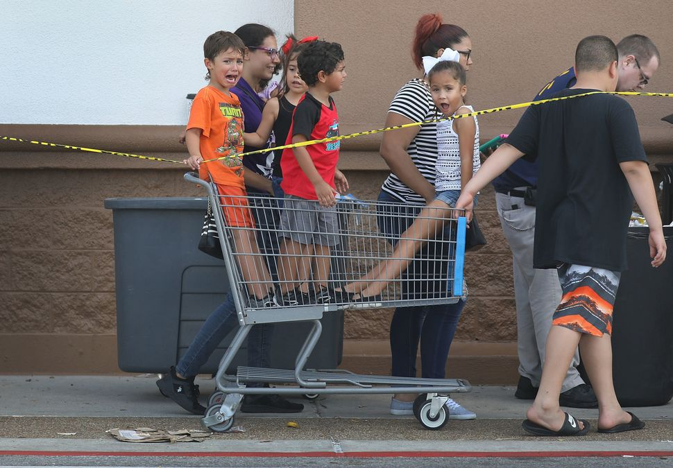 People stand in line at a Walmart store to purchase items in Panama City.