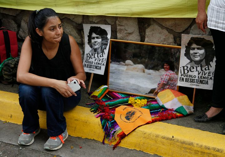 Laura Zuniga Caceres, daughter of Honduran indigenous and environmental rights activist Berta Caceres, sits outside the court